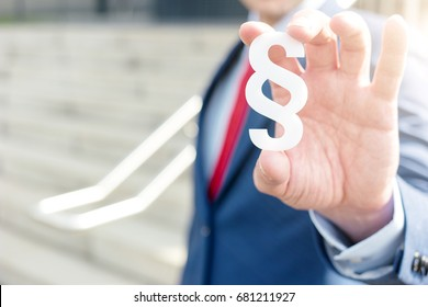 lawyer holding paragraph symbol - law concept image