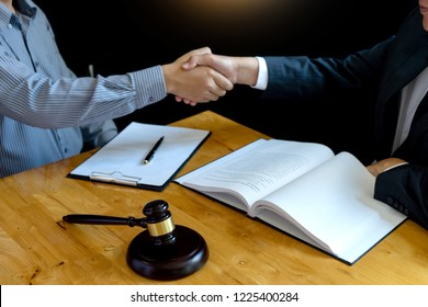 Lawyer or judge gavel with balance handshake with client or customer about agreement how to  use arbitration