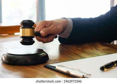 Lawyer Legal counsel presents to bid sale judgment mallet with judgeReal estate auction bid property sale judgment with Gavel