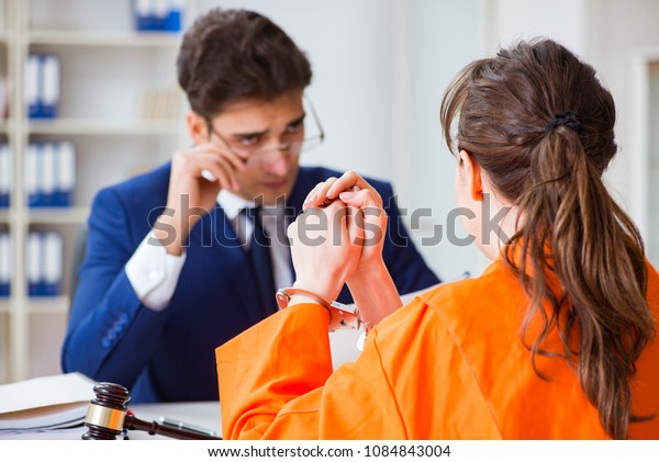 Lawyer meeting his client in prison