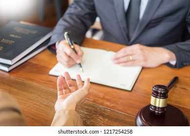 lawyer in office. Counseling and giving advice about legal legislation in courtroom to help customer, tribunal and justice concept.
