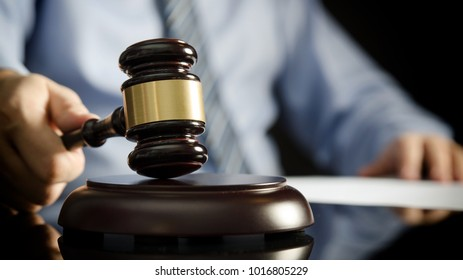 Lawyer in office with gavel, symbol of justice. Legal authority rights concept