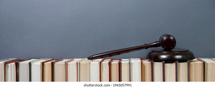 Lawyer office. Judge gavel and law books, banner