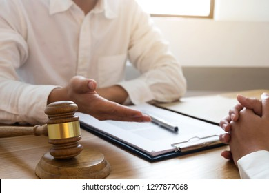 Lawyer present client with contract papers on the table in office. consultant lawyer, attorney, court judge, concept.