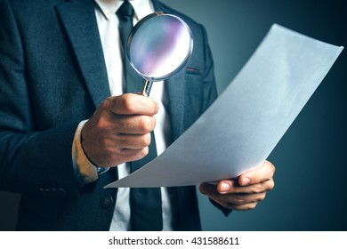 Lawyer reading legal contract agreement disclaimer with magnifying glass