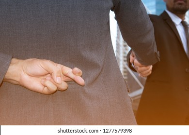 Lawyer shake hands together and holding another fingers crossed behind his back,Honesty isn't always,lie,Dishonest consultation between a male lawyer and customer,Trickery Concept