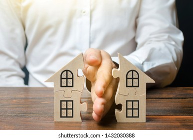 A lawyer shares a house or property between owners. Divorce concept. The division process of real estate and property between former spouses, relatives. Execution of the posthumous will.