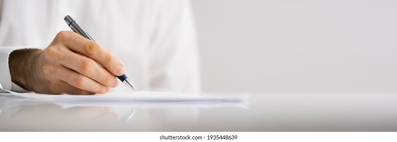 Lawyer Signing Business Contract Document At Meeting