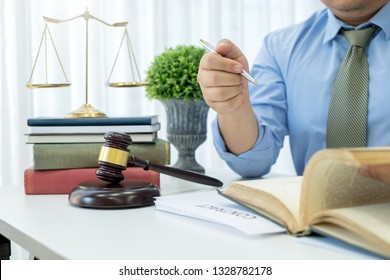 Lawyer sitting working in a lawyer office. Open a book providing legal advice.