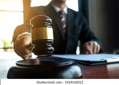 Lawyer working with contract papers on the table in office. consultant lawyer, attorney, court judge, concept.