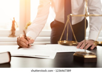 Lawyer working with documents. Justice and law, attorney, concept. Man signing contract papers