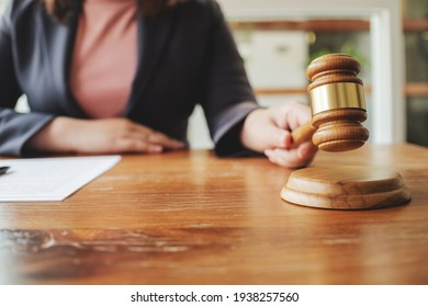 Lawyer working with lawsuit in courtroom, Criminal and judgement concept.