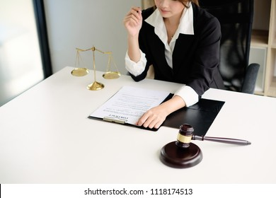 Lawyer working on a documents. Legal law, advice and justice concept.