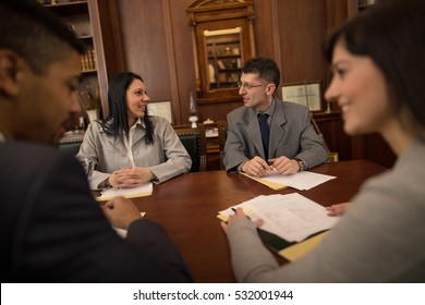 lawyers or attorneys discussing a document or contract agreement