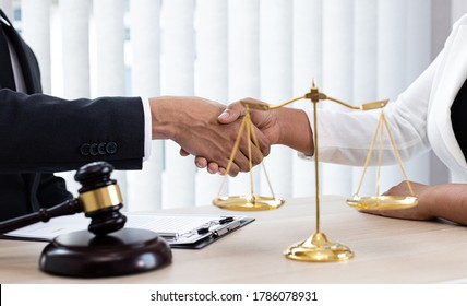 Lawyers or counselors join hands with clients to congratulate the end of the case by the company, Negotiation or settlement of lawsuits concept.