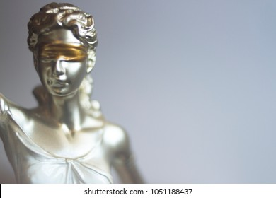 Lawyers legal blind justice bronze statue Themis and scales in attorneys law firm offices.