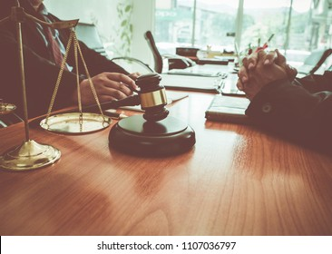 Lawyers team provides legal counsel to a husband who is having problems with his wife about divorce.