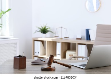Lawyer's workplace with laptop in office