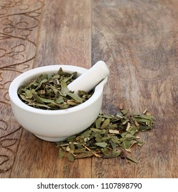 Laxative and constipation herb mixture used in alternative herbal medicine with senna leaf, fennel, elder and lime flowers on white background.