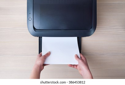lay down or take  paper from the printer, a top view
