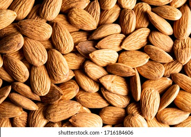 Lay flat almond dry fruits against a white background for a wall paper