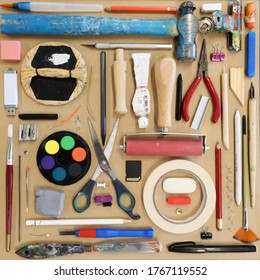 A lay flat arrangment of a variety of visual art creative tools, utensils and objects in a colorful square arrangement or pattern. Creativity, creative possibility possibilities.