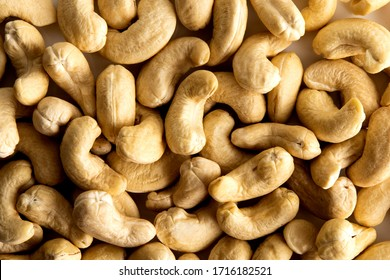 Lay flat cashew nuts dry fruits against a white background for a wall paper