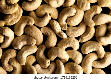 Lay flat cashew nuts dry fruits against a dark background for a wall paper
