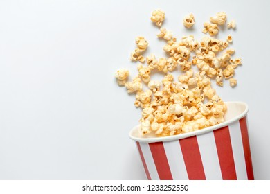 Lay popcorn Blast on a scattered gray isolate scene.