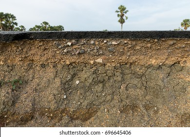 The layer of asphalt road with soil and rock.