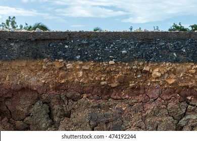 The layer of asphalt with soil and rock. Un-focus image.