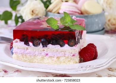 Layer fruit cake decorated with lemon balm leaf.