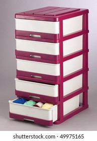 Layer plastic drawer with one drawer half open that has cotton wools in it.