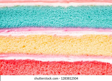 layer rainbow cake and  whip cream background,dessert homemade colorful