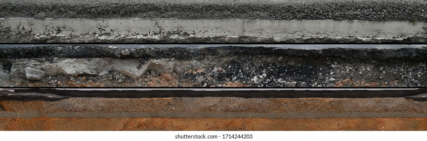 Layered asphalt road side texture with soil geology cross section underground earth, cutaway tar road  terrain surface