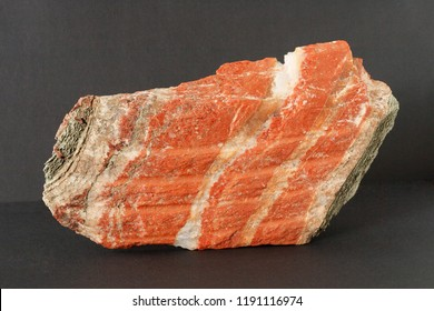 Layered cake of sylvinite mineral also potash or or potassium chloride  with sodium chloride from Belarus Soligorsk region on black background potentially for economic and agricultural fertilizers mar