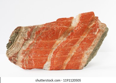 Layered cake of sylvinite mineral also potash or or potassium chloride  with sodium chloride from Belarus Soligorsk region on white background potentially for economic and agricultural fertilizers mar