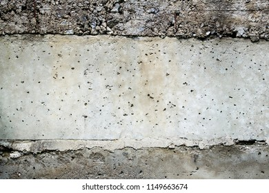 Layered concrete surface with gravel stones in the layers