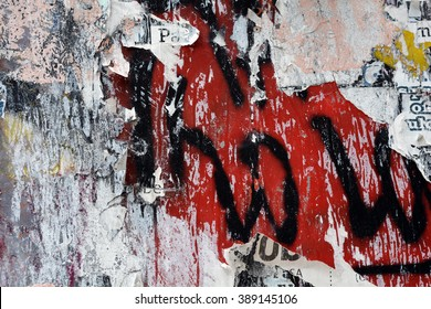 a layered graffiti and torn poster background