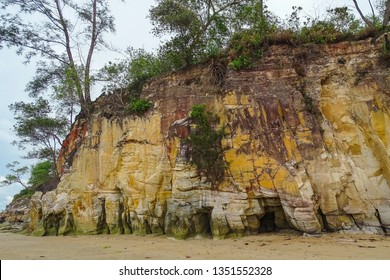 Layered hill rocks and paradise white sand Tanjung Kubong tropical beach located at the northern tip of Labuan Island. It is also the place where the famous chimney standing.