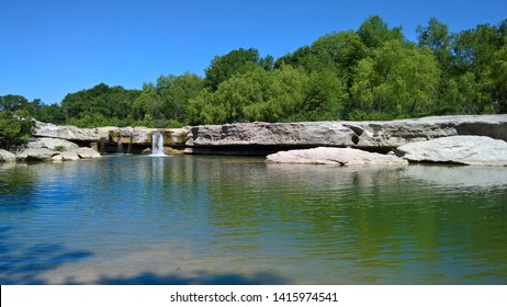 layered rock by a natural pool perfect for swimming
