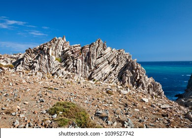 Layered rocks on the southern coast of Crete. The Mediterranean. The Libyan Sea. Greece.
