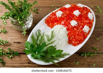 Layered salad in the shape of a mushroom. Decoration is made of eggs and tomatoes