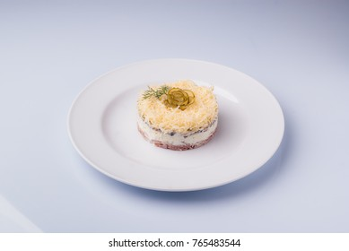 layered salad with tongue and pickled cucumber