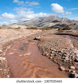 """Layered sedimentary rocks in the colorful valley of the Rio Grande (Spanish for """"great river""""), south of Mendoza Province, Argentina"""