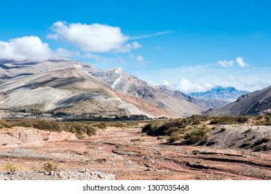 "Layered sedimentary rocks in the colorful valley of the Rio Grande (Spanish for ""great river""), south of Mendoza Province, Argentina"