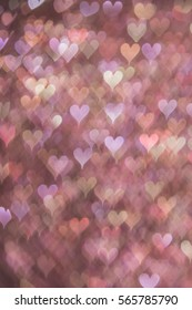 Layered soft pink bokeh hearts background. Modern, abstract flat design for card or website.