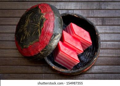 Layered steamed cake kuih lapis in traditional basket