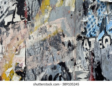 a layered texture background of torn posters and spray paint