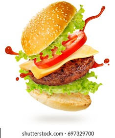 layers of cheeseburger floating on white background
